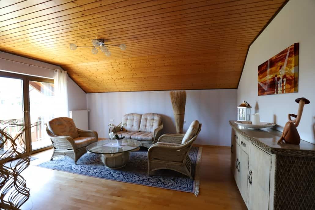 Wohnzimmer mit Rattan Möbel